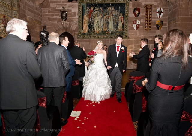 Newlyweds enjoy the splendor of the Great Hall in the presence of their guests