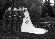 Relaxing groomsmen with the bride