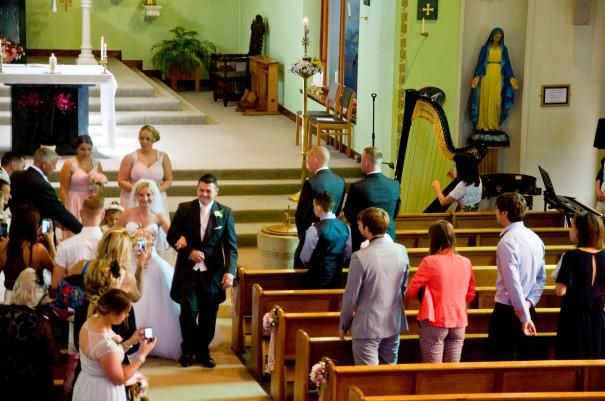 Oona Linnett harpist plays for church wedding ceremonies