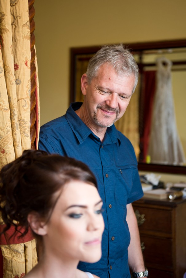 Father of the bride helping with bridal preparations