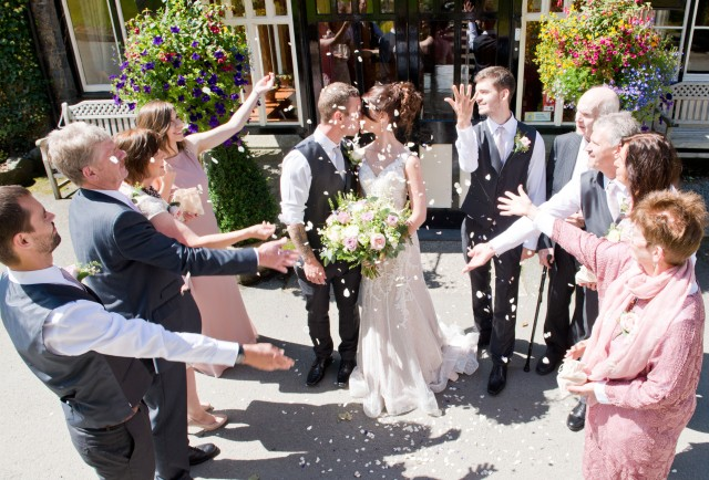 Confetti moment outside Lake Vyrnwy Hotel