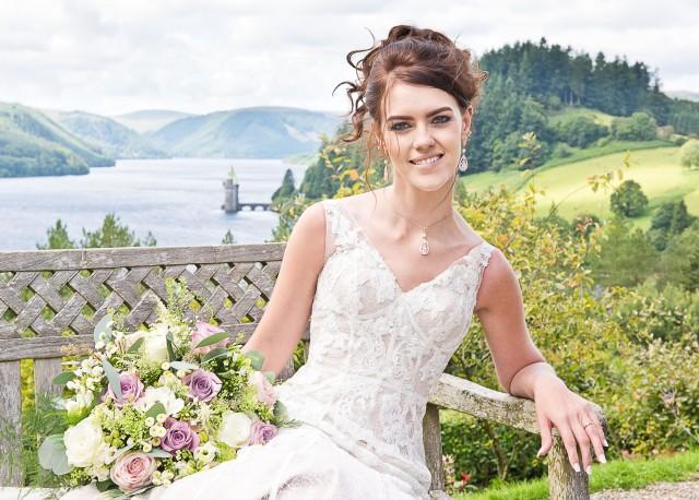 Bride enjoys the view at Lake Vyrnwy
