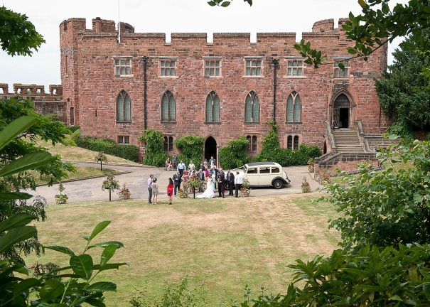 Wedding party enjoy drinks on the lawn at Shrewsbury Castle.