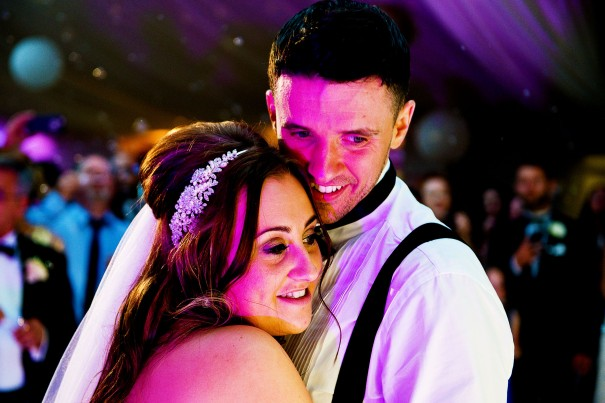 Evening disco lighting can add saturation and colour to the wedding images