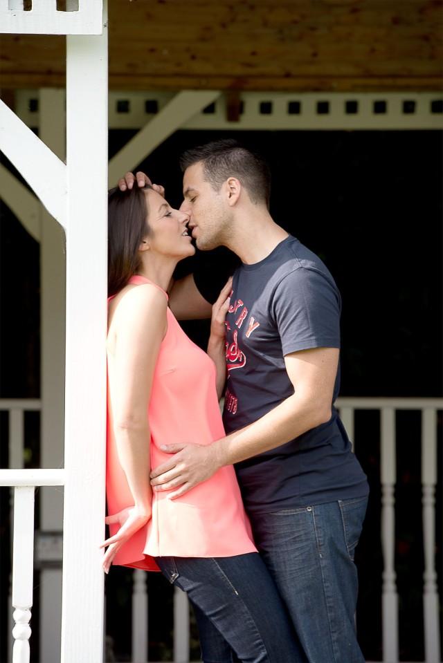 Romantic and sensual engagement portrait kiss