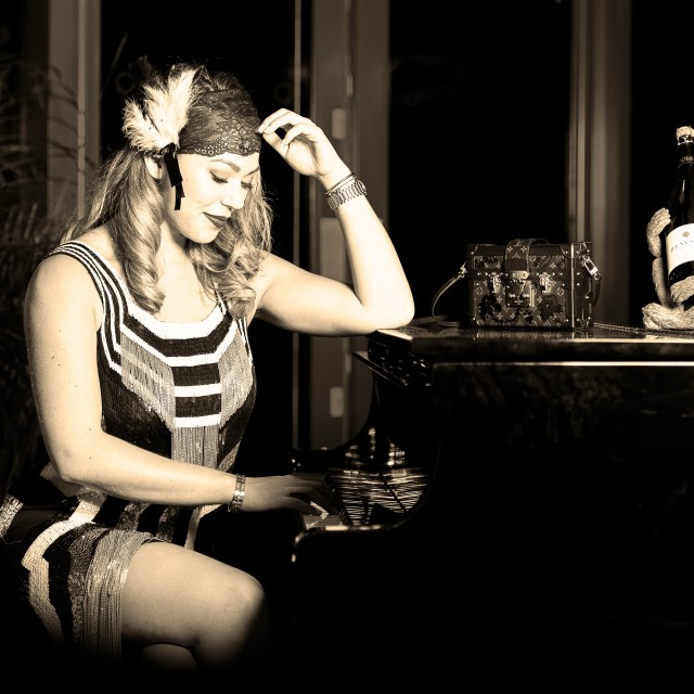Flapper portrait at the piano Hencote's The View restaurant