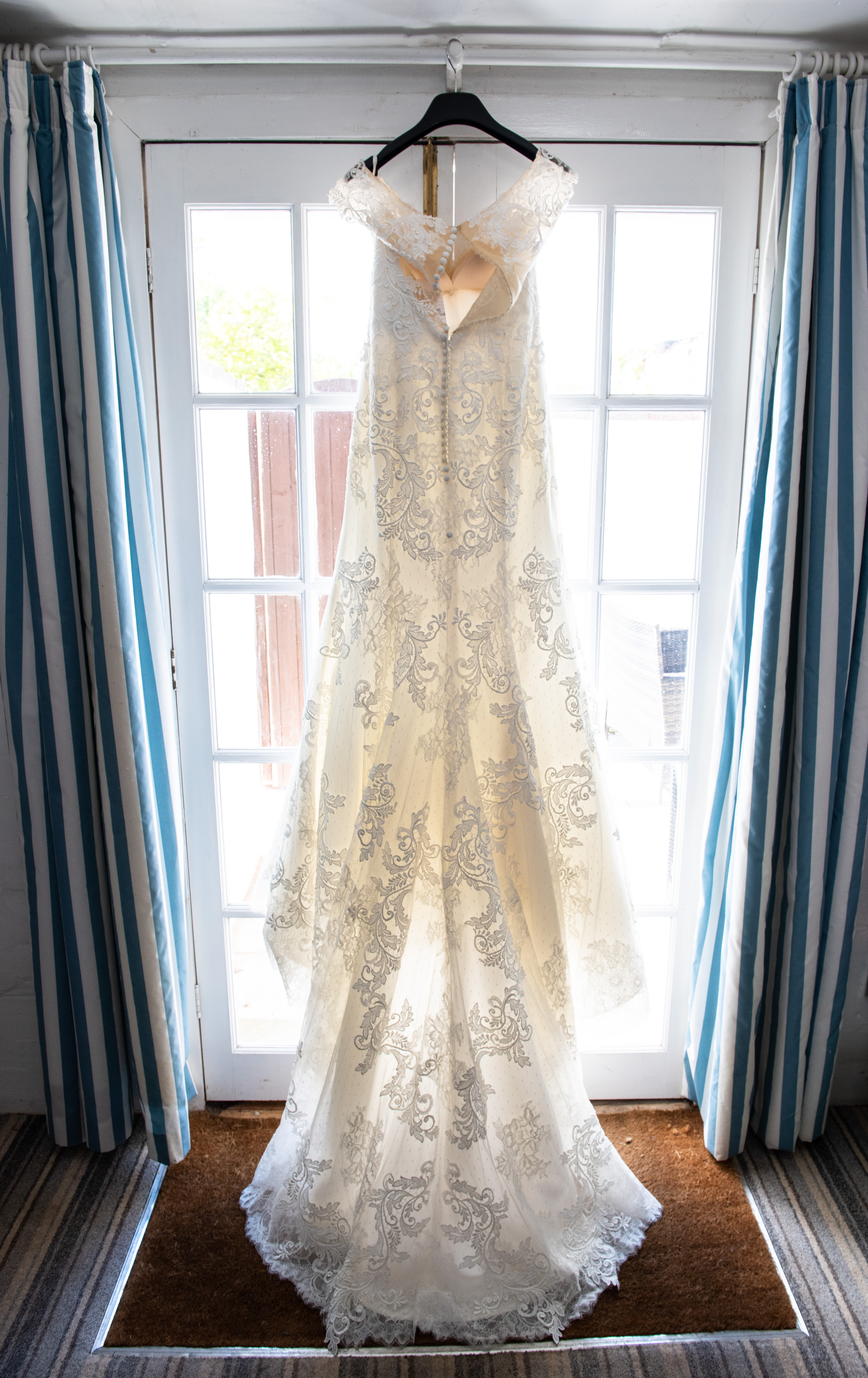 Wedding dress backlit in the doorway.