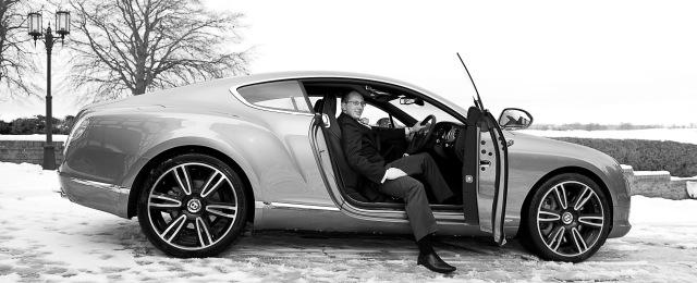 Groom with Bentley prestige car.