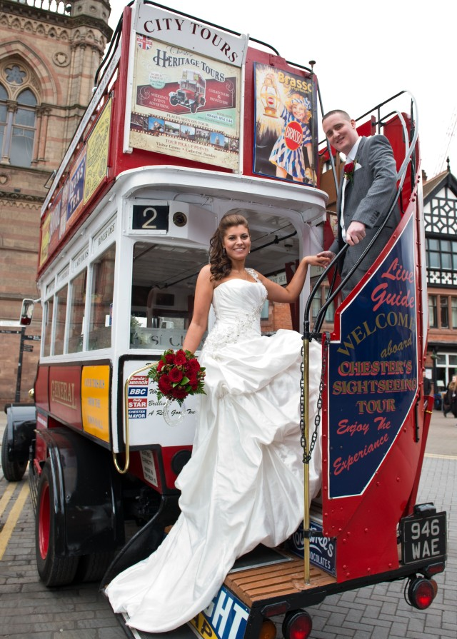 Vintage bus with bride and groom.