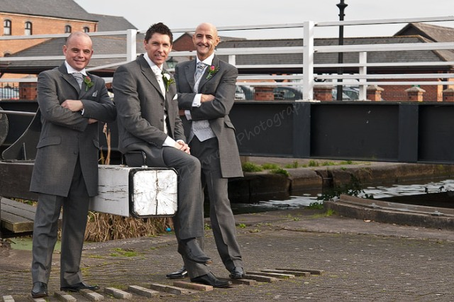 Relaxed groom canalside.
