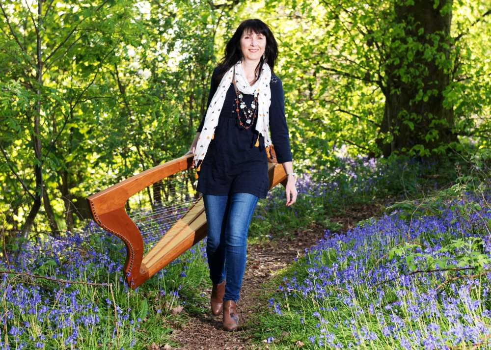 Oona Linnett harpist and the bluebells.