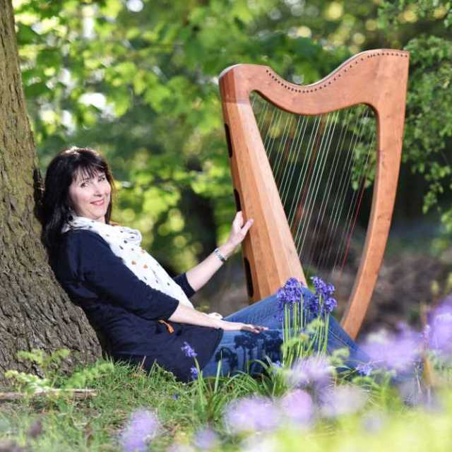 Oona relaxing with her celtic harp.