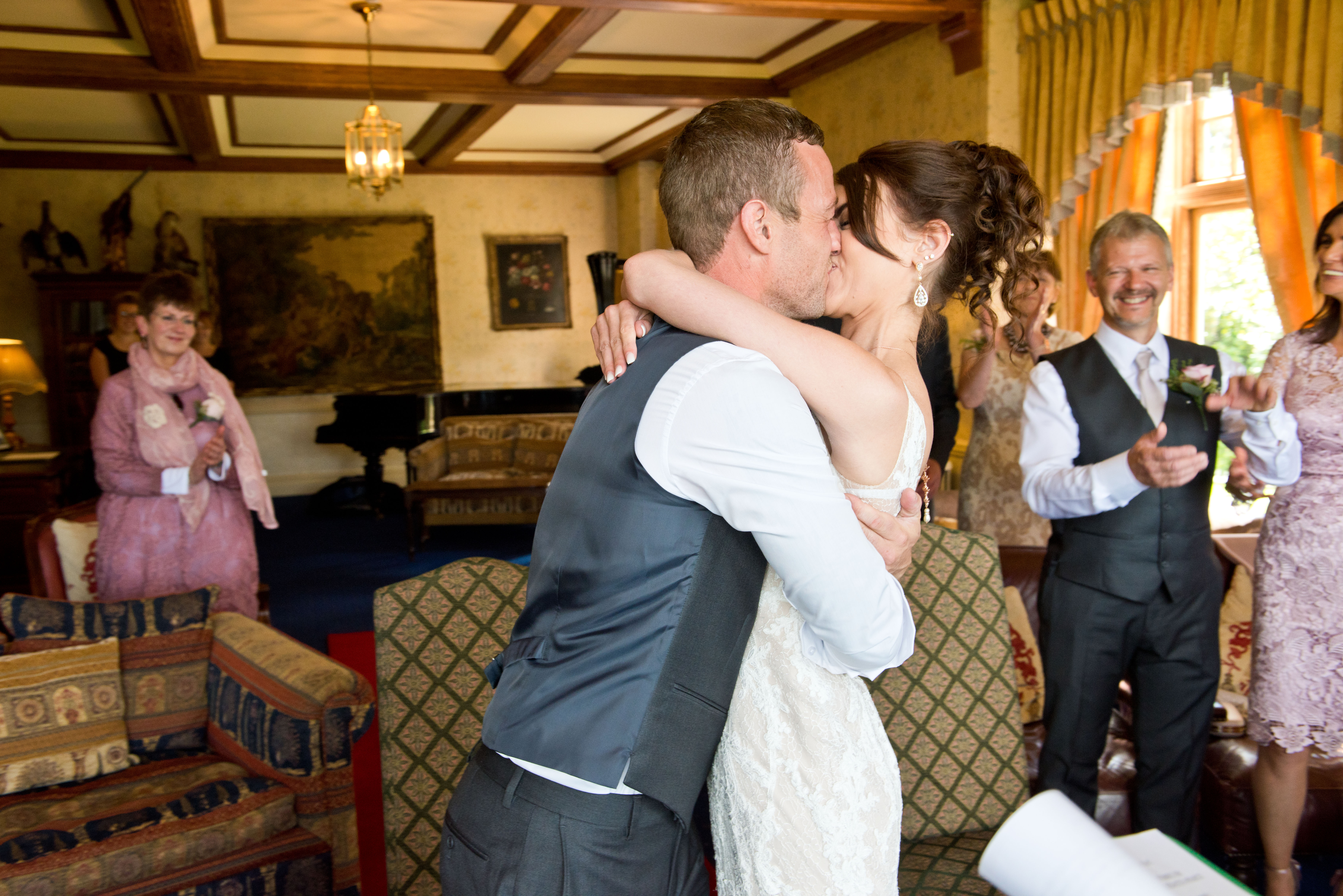 Lake Vyrnwy Hotel and Spa wedding kiss.