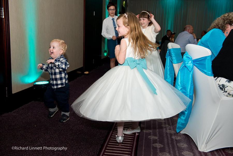 Bridesmaid enjoys twirling her dress.