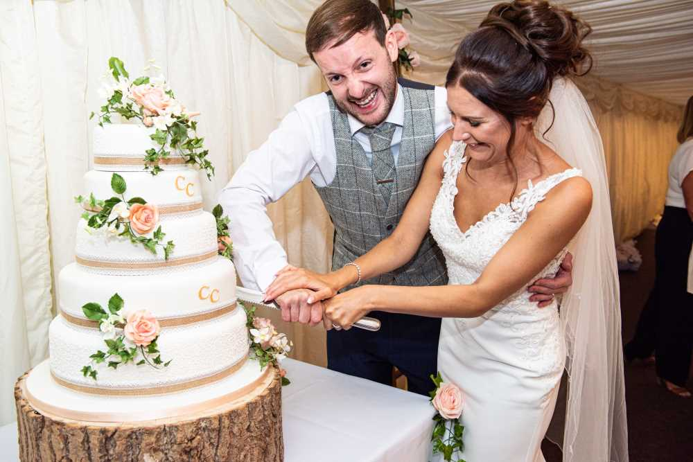 Bride and groom really cut the cake.