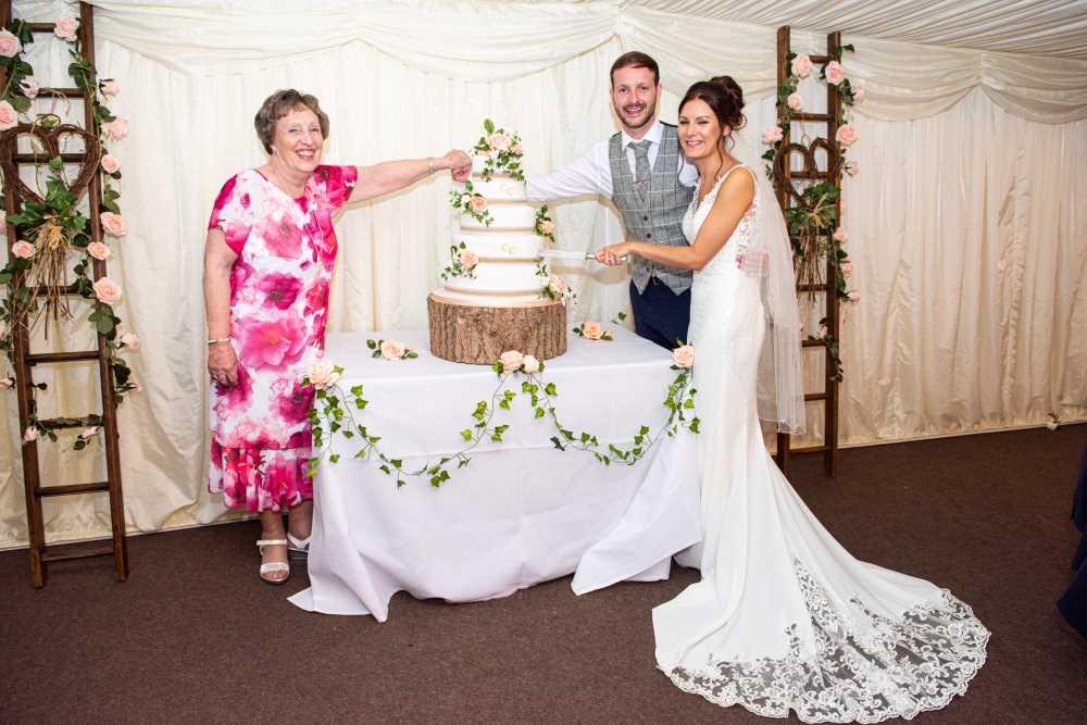 Plas Isaf cake cutting at wedding with Mum!