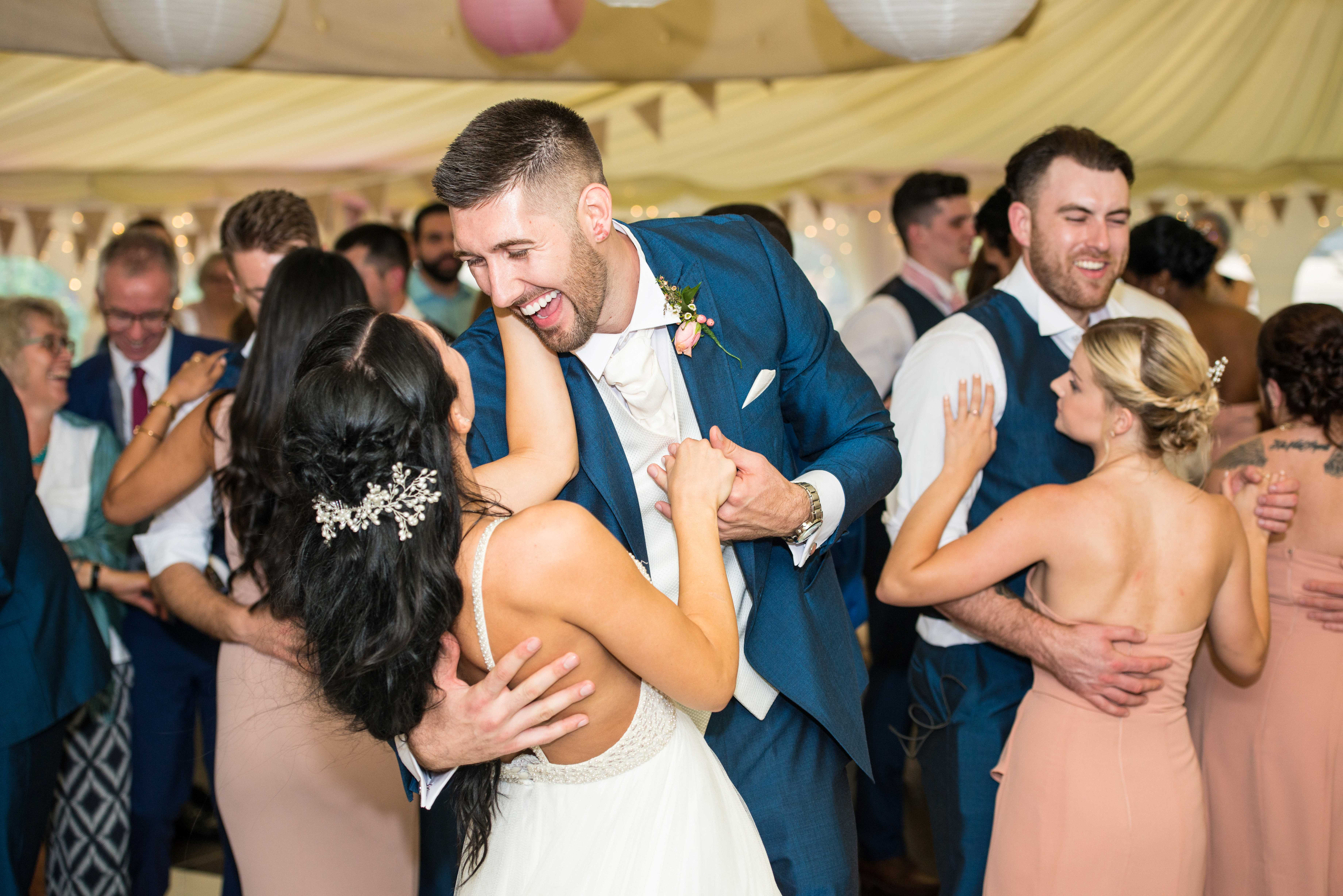 Everyone joins in dancing with the bride and groom as they complete their first dance as husband and wife.