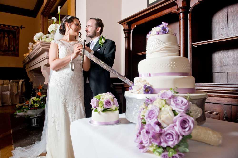 Peckforton Castle wedding cake cutting.