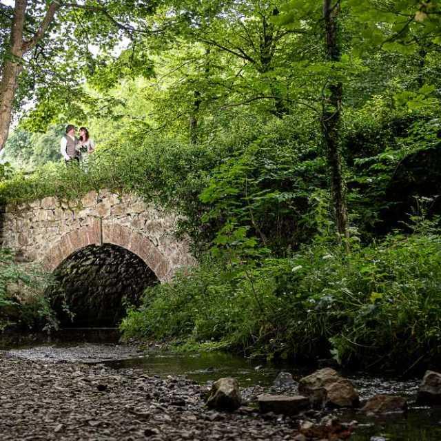 Fairy bridge on the River Alyn. Wedding portrait.