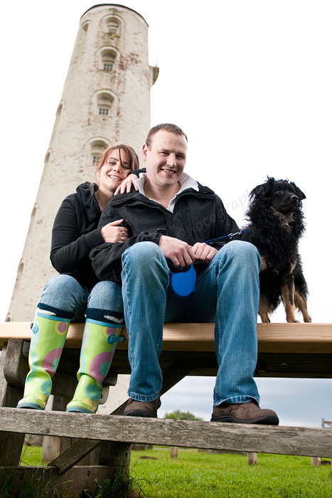 Engaged couple shoot with their pet dog.